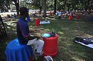 "Joseph Reed, a drummer in the University of Mississippi's ""Pride of the South"" marching band, practices while reserving a tailgating spot in the Grove at the University of Mississippi in Oxford, Miss. on Friday, October 3, 2014.  Mississippi plays host to Alabama on Saturday. (AP Photo/Oxford Eagle, Bruce Newman)"