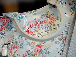 File photo dated 13/08/13 of a Cath Kidston bag in the window display at the Cath Kidston store, as the clothing and homewares retailer has swung into profit after sales at its overseas business helped mitigate the impact of the collapse in sterling following the Brexit vote.
