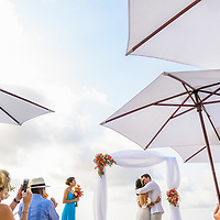 Maxine & Rick's first kiss during their beautiful ceremony at the beach in Sayulita, Mexico. Photo by: Melissa Suneson