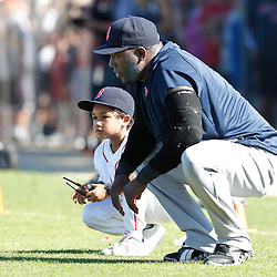 February 19, 2011; Fort Myers, FL, USA; Boston Red Sox first baseman David Ortiz (34) and son D'Angelo Ortiz stretch during spring training practice at the Player Development Complex.  Mandatory Credit: Derick E. Hingle