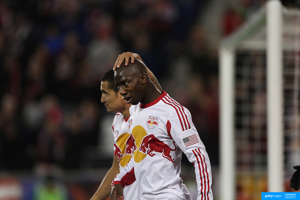 Bradley Wright-Phillips, New York Red Bulls, is congratulated by Tim Cahill after scoring the winning goal in the 90th minute to lead his side to a 2-1 victory during the New York Red Bulls V Sporting Kansas City, Major League Soccer Play Off Match at Red Bull Arena, Harrison, New Jersey. USA. 30th October 2014. Photo Tim Clayton
