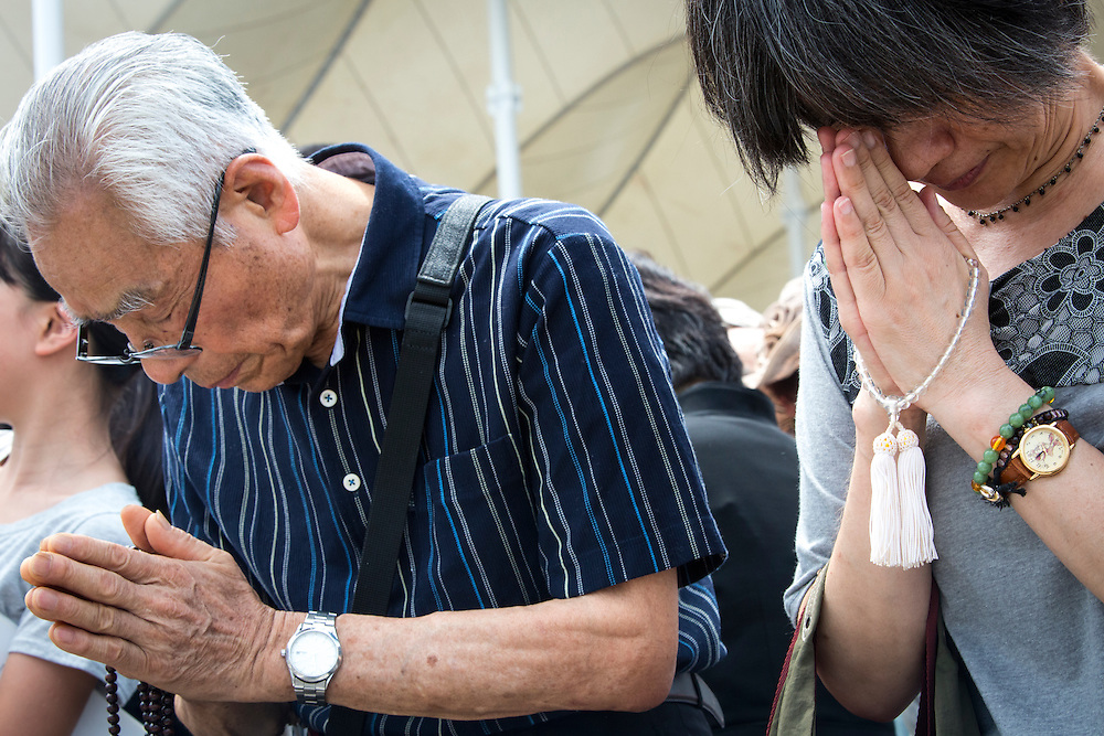 NAGASAKI, JAPAN - AUGUST 9 : Visitors pray for the atomic bomb victims in front of the Peace Statue in Nagasaki Peace Park, Nagasaki, southern Japan, Tuesday, August 9, 2016. Japan marked the 71st anniversary of the atomic bombing on Nagasaki. On August 9, 1945, during World War II, the United States dropped the second Atomic bomb on Nagasaki city, killing an estimated 40,000 people which ended World War II. (Photo by Richard Atrero de Guzman/NURPhoto)