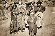 Berber family with mules in the Todra Canyon, Morocco.