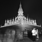 Devotees circle Pha That Luang during a full moon festival in Vientiane, Laos.