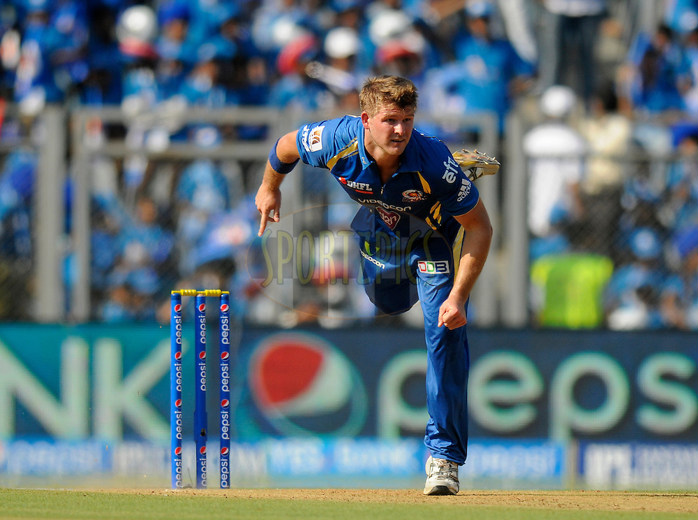 Corey Anderson of the Mumbai Indians bowls during match 22 of the Pepsi Indian Premier League Season 2014 between the Mumbai Indians and the Kings XI Punjab held at the Wankhede Cricket Stadium, Mumbai, India on the 3rd May  2014<br /> <br /> Photo by Pal Pillai / IPL / SPORTZPICS<br /> <br /> <br /> <br /> Image use subject to terms and conditions which can be found here:  http://sportzpics.photoshelter.com/gallery/Pepsi-IPL-Image-terms-and-conditions/G00004VW1IVJ.gB0/C0000TScjhBM6ikg