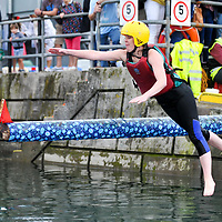 Noelle Cooney, Kinsale makes a grab for the flag during the Greasy Pole competition at the Water Carnival on Bank Holiday  Monday at the Kinsale Regatta.<br /> Picture. John Allen