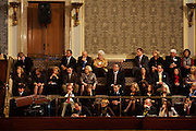 Onlookers watch as congressmen are sworn in at the beginning of the 112th Congress at the United States Capital in Washington, DC on Wednesday, January 5, 2011.