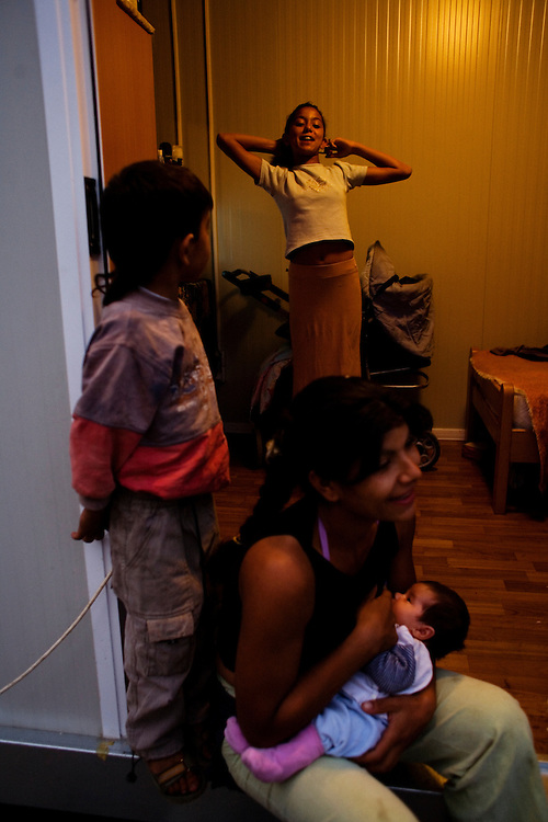 A family in their new container home at the Rakovica resettlement camp for Roma displaced from Gazela.