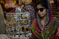 June 26, 2017 - Lahore, Punjab, Pakistan - Pakistani woman eid shopping at Anarkali Bazaar during her Eid al Fitr shopping on 'Chand Raat' in Lahore. Eid-ul-Fitr is an important religious festival celebrated worldwide by Muslims with great zeal and enthusiasm. Eid al-Fitr ''feast of breaking of the fast'' is an important religious holiday celebrated by Muslims worldwide that marks the end of Ramadan, and first day of Shawwal according to Islamic Hijri cleaner. (Credit Image: © Rana Sajid Hussain/Pacific Press via ZUMA Wire)