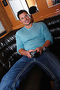 CINCINNATI, OH - OCTOBER 5:  Nick Lachey relaxes in the tour bus he will be traveling in during the kickoff to The Everybody Wins Tour at Freestore Foodbank on October 5, 2009 in Cincinnati, Ohio. (Photo by Joe Robbins/WireImage for Foodbank)