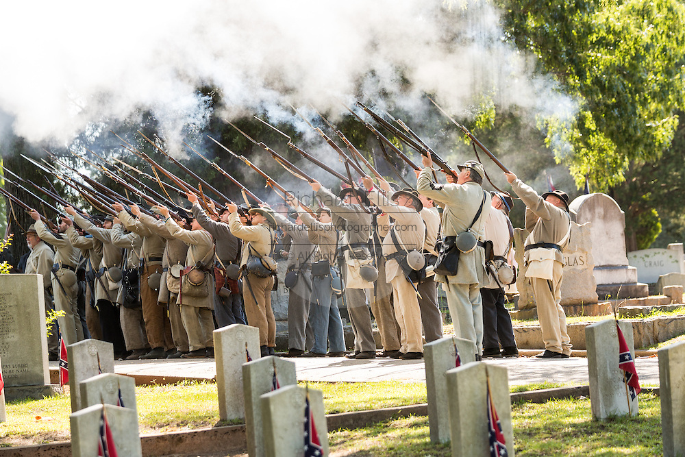 Civil war re-enactors in period costume fire their rifles in honor during a service at Elmwood Cemetery to mark Confederate Memorial Day May 2, 2015 in Columbia, SC. Confederate Memorial Day is a official state holiday in South Carolina and honors those that served during the Civil War.