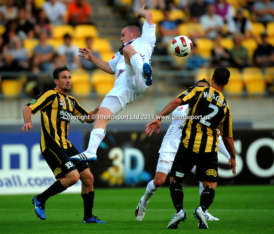 Victory's Leigh Broxham goes flying after a collision with Manny Muscat. A-League football - Wellington Phoenix v Melbourne Victory at Westpac Stadium, Wellington, New Zealand on Wednesday, 5 January 2011. Photo: Dave Lintott/PHOTOSPORT