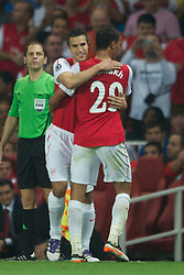 LONDON, ENGLAND - WEDNESDAY, SEPTEMBER 28, 2011: Arsenal's Robin Van Persie replaces team-mate Marouane Chamakh during the UEFA Champions League Group F match at the Emirates Stadium. (Photo by Chris Brunskill/Propaganda)