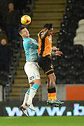 Derby County's Jason Shackell and Hull City striker Abel Hernandez go for the ball  during the Sky Bet Championship match between Hull City and Derby County at the KC Stadium, Kingston upon Hull, England on 27 November 2015. Photo by Ian Lyall.