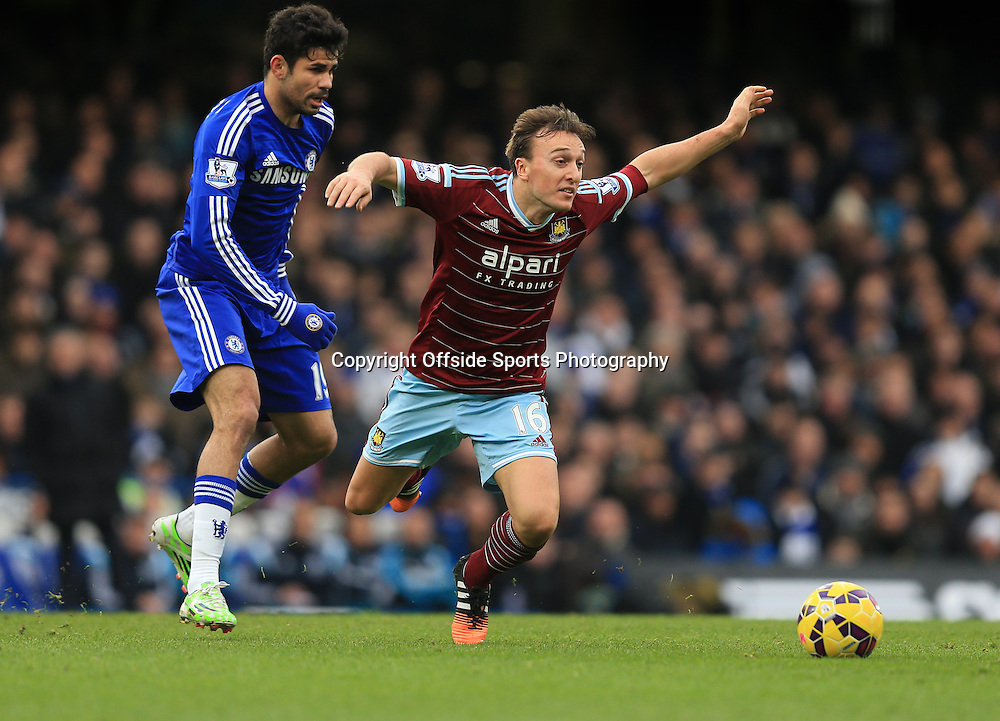 26 December 2014 - Barclays Premier League - Chelsea v West Ham  Diego Costa of Chelsea in action with Mark Noble of West Ham - Photo: Marc Atkins / Offside.