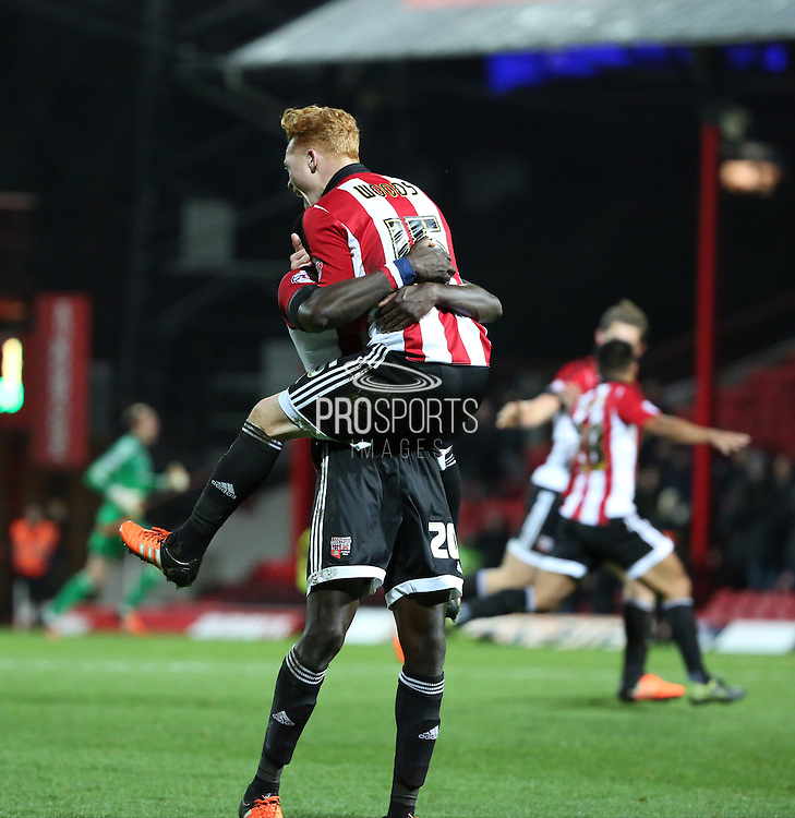 Brentford midfielder Ryan Woods celebrating the win with Brentford midfielder Toumani Diagouraga during the Sky Bet Championship match between Brentford and Nottingham Forest at Griffin Park, London, England on 21 November 2015. Photo by Matthew Redman.