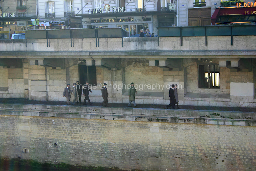 Actors in period costume during filming along the banks of the River Seine, Paris, France<br />