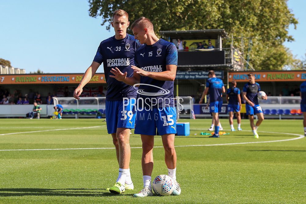AFC Wimbledon attacker Marcus Forss (15) talking with AFC Wimbledon striker Joe Pigott (39) prior to kick off during the EFL Sky Bet League 1 match between AFC Wimbledon and Shrewsbury Town at the Cherry Red Records Stadium, Kingston, England on 14 September 2019.