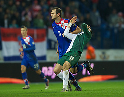 OSIJEK, CROATIA - Tuesday, October 16, 2012: Croatia's Josip Simunic in action against Wales' Gareth Bale during the Brazil 2014 FIFA World Cup Qualifying Group A match at the Stadion Gradski Vrt. (Pic by David Rawcliffe/Propaganda)