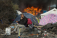 Calais, Pas-de-Calais, France - 26.10.2016    <br />  <br /> Since the beginning of the governmental<br />  camp destruction on the day before many fires were placed by camp residents inside camp. Wide parts of the camp burned down. 3rd day of the eviction on the so called &rdquo;Jungle&quot; refugee camp on the outskirts of the French city of Calais. Many thousands of migrants and refugees are waiting in some cases for years in the port city in the hope of being able to cross the English Channel to Britain. French authorities announced a week ago that they will evict the camp where currently up to up to 10,000 people live.<br /> <br /> Seit dem Beginn der behoerdlichen Campzerst&ouml;rung wurden zahlreiche Feuer im Camp gelegt. Weite Teile des Camps brannten ab. Dritter Tag der Raeumung des so genannte &rdquo;Jungle&rdquo;-Fluechtlingscamp in der franz&ouml;sischen Hafenstadt Calais. Viele tausend Migranten und Fluechtlinge harren teilweise seit Jahren in der Hafenstadt aus in der Hoffnung den Aermelkanal nach Gro&szlig;britannien ueberqueren zu koennen. Die franzoesischen Behoerden kuendigten vor einigen Wochen an, dass sie das Camp, indem derzeit bis zu bis zu 10.000 Menschen leben raeumen werden. <br /> <br /> Photo: Bjoern Kietzmann