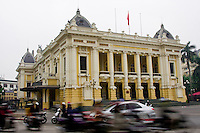 The French colonial architecture of the Hanoi Opera House stands stately in the hustle and bustle that signifies Vietnam.