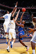 INDIANAPOLIS, IN - NOVEMBER 18: Wayne Selden Jr. #1 of the Kansas Jayhawks is defended by Devin Booker #1 and Marcus Lee #00 of the Kentucky Wildcats during the Champions Classic basketball event at Bankers Life Fieldhouse on November 18, 2014 in Indianapolis, Indiana. The Wildcats defeated the Jayhawks 72-40. (Photo by Joe Robbins)