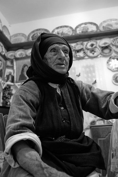 An elder woman in Olympos village, Karpathos island, Dodecanese islands, Greece.