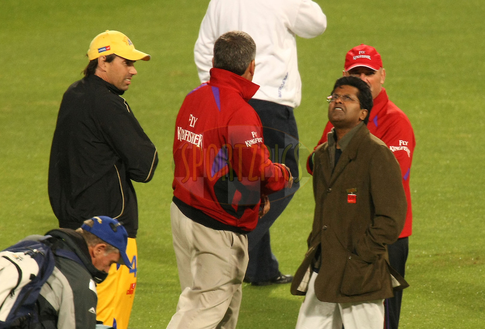 CAPE TOWN, SOUTH AFRICA - 25 April 2009, Mr Lalit Modi checks the skies during the IPL Season 2 match between The Chennai Superkings  and The Kolkata Knight Riders held at Sahara Park Newlands in Cape Town, South Africa..