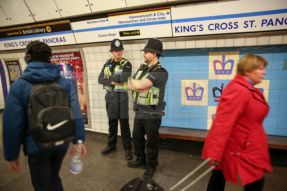 © Licensed to London News Pictures. 17/04/2019. London, UK. British Transport Police Officers at Kings Cross Underground station platform as the Extinction Rebellion group plans to cause disruption on London Underground demanding decisive action from the UK Government on the environmental crisis. Photo credit: Dinendra Haria/LNP