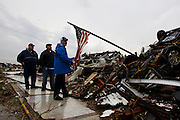 May 23, 2011- Pepsi Warehouse Manager Alan Gouge straightens an American flag in the remains of the Pepsi distribution plant in Joplin, Missouri after a Tornado came through the town on Sunday, May 22, 2011. The tornado left over 100 people  dead and over 1,000 missing. Credit: David Welker / TurfImages.com.