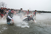 Ohio University students rush into the freezing cold water of Lake Snowdon to raise money for the Special Olympics during the annual Polar Plunge.