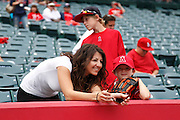 ANAHEIM, CA - MAY 08:  A mother and her young son watch the Mother's Day game between the Cleveland Indians and the Los Angeles Angels of Anaheim on Sunday, May 8, 2011 at Angel Stadium in Anaheim, California. The Angels won the game 6-5. (Photo by Paul Spinelli/MLB Photos via Getty Images)