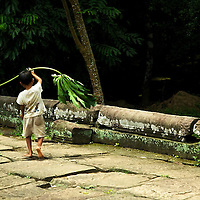 Little boy playing at one of Angkor's temples