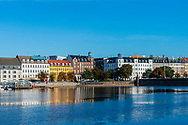 A picture of the sparkling waters with beautiful architecture by Norrebro in Copenhagen.