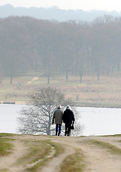 ©London News pictures. 04/03/2011. A elderly couple couple walk in the hazy sunshine in Richmond Park, London, today (Fri).  Picture Credit should read Stephen Simpson/LNP