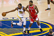 Golden State Warriors forward Kevin Durant (35) scrambles for a loose ball against Houston Rockets forward Trevor Ariza (1) during Game 3 of the Western Conference Finals at Oracle Arena in Oakland, Calif., on May 20, 2018. (Stan Olszewski/Special to S.F. Examiner)