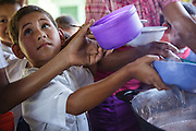 Children get served lunch at the primary school in the town of Coyolito, Honduras on Wednesday April 24, 2013.