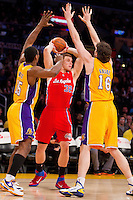 25 February 2011: Forward Blake Griffin of the Los Angeles Clippers looks to pass while being guarded by Ron Artest and Pau Gasol of the Los Angeles Lakers during the first half of the Lakers 108-95 victory over the Clippers at the STAPLES Center in Los Angeles, CA.