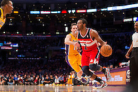 22 March 2013: Guard (2) John Wall of the Washington Wizards drives to the basket while being guarded by Steve Nash of the Los Angeles Lakers during the first half of the Wizards 103-100 victory over the Lakers at the STAPLES Center in Los Angeles, CA.
