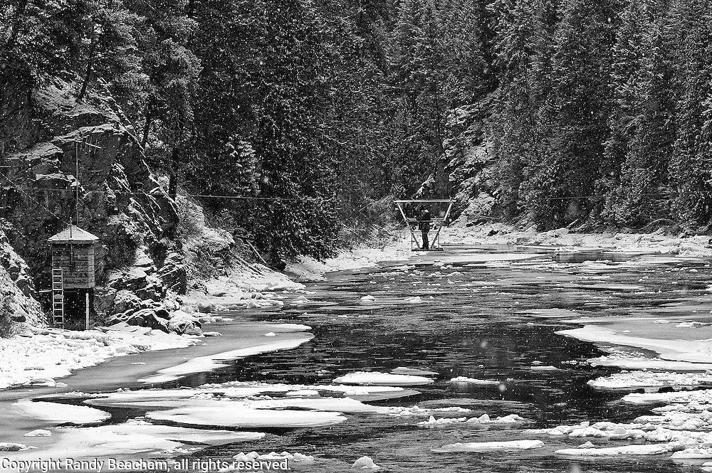 Working on a USGS stream data site over the Yaak River in winter. Kootenai River Valley, Montana.