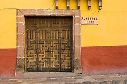 Colonial wood door in San Miguel de Allende, Mexico.
