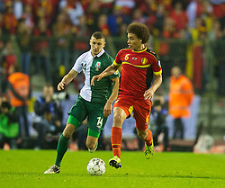 BRUSSELS, BELGIUM - Tuesday, October 15, 2013: Wales' James Wilson in action against Belgium's Axel Witsel during the 2014 FIFA World Cup Brazil Qualifying Group A match at the Koning Boudewijnstadion. (Pic by David Rawcliffe/Propaganda)