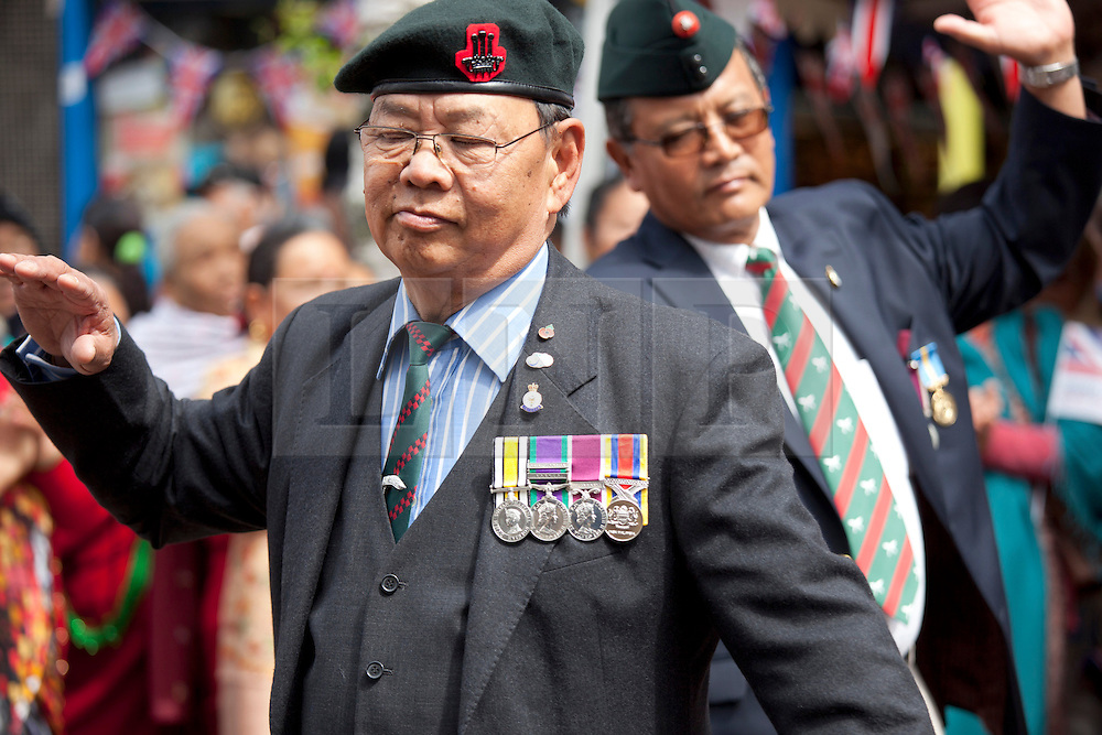 © Licensed to London News Pictures. 29/06/2013. Nuneaton, WARKS, UK. Armed Foces Day took  place in Nuneaton, where the 30th Signal Regiment comprised partly of Gurkas are based in nearby Bramcote Barracks. The Gurkhas have a long traddition with Nuneaton, with over five hundred ex-servicemen and their families now living there. Many of the Gurkha families came out into the centre of the town to take part in the Armed Forces Day, bringing the town alive with their native Nepalese dancing and unique musical band. Pictured, Gurkha families dancing and making music in the centre of Nuneaton to celebrate Armed Forces Day. Photo credit : Dave Warren/LNP