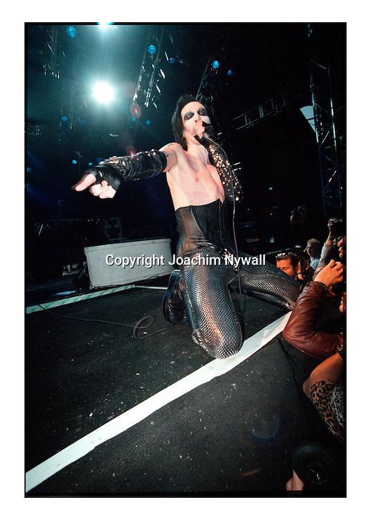 Hultsfred  1999 Hultsfredsfestivalen<br /> Marilyn Manson<br /> <br /> <br /> <br /> FOTO JOACHIM NYWALL KOD0708840825<br /> COPYRIGHT JOACHIMNYWALL:SE<br /> <br /> ****BETALBILD****<br />  <br /> Redovisas till: Joachim Nywall<br /> Strandgatan 30<br /> 461 31 Trollh&auml;ttan<br />  Prislista: BLF, om ej annat avtalats