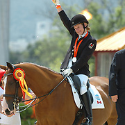 Lauren Barwick celebatres individual silver in the grade II with Maile, Paralympic Games Hong Kong