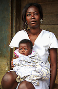 A Ghanaian woman with her baby. She is a beneficiary of the Ghana Beds Project which provided mattresses for a group of women living with HIV/AIDS.