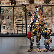 """Venezia - Punta della Dogana . La mostra di Damien Hirst: """"Tresaures from the Wreck of Unbelievable. The collector with friend""""."""