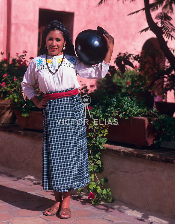 Dancer in costume for Guelaguetza festival. Oaxaca, Mexico.