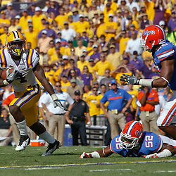 October 8, 2011; Baton Rouge, LA, USA; LSU Tigers running back Alfred Blue (4) runs from Florida Gators defensive end William Green (96) and linebacker Jonathan Bostic (52) during the first quarter at Tiger Stadium.  Mandatory Credit: Derick E. Hingle-US PRESSWIRE / © Derick E. Hingle 2011