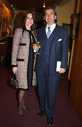 MR & MRS DIMITRI HORNE at a reception to support The Hyde Park Appeal held in the Officers Mess, Household Cavalry Mounted Regiment, Hype Park Barracks, Knightsbridge, London SW1 on 30th November 2004.<br />